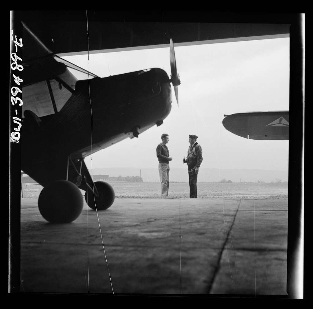 Frederick, Maryland. Walter Spangenberg, a student at Woodrow Wilson High School, talking to a friend at the Stevens Airport where he takes lessons