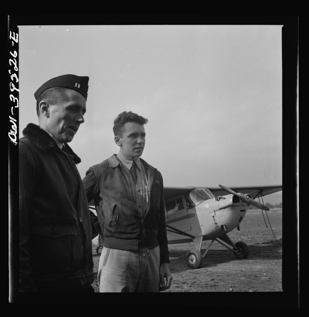 Frederick, Maryland. Walter Spangenberg, a student at Woodrow Wilson High School, and a friend at the Stevens Airport