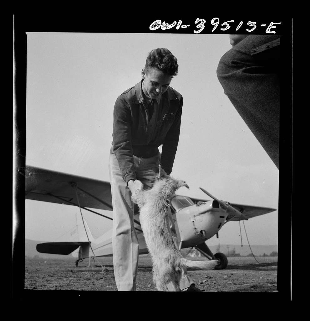 """Frederick, Maryland. Walter Spangenberg, a student at Woodrow Wilson High School, and """"Greaseball,"""" a mascot at the Stevens Airfield"""