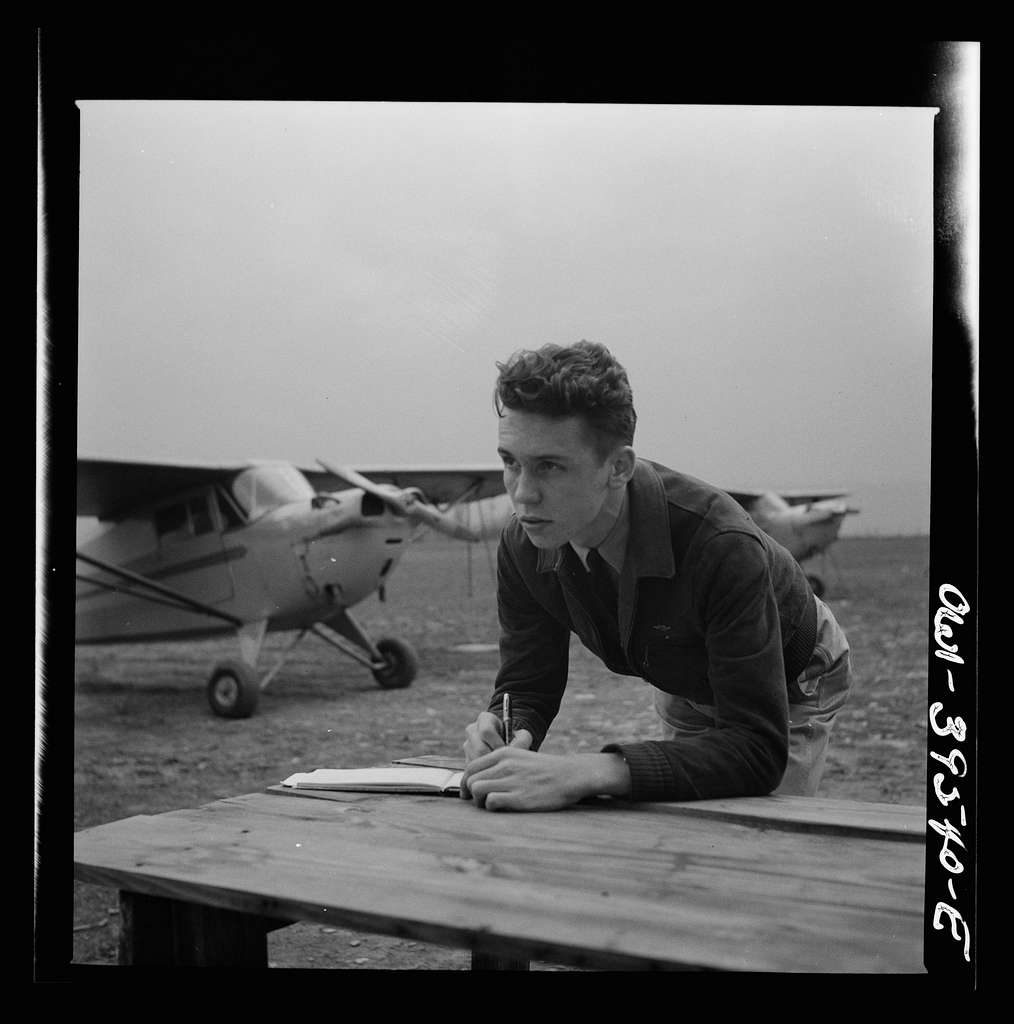 Frederick, Maryland. Walter Spangenberg, a student at Woodrow Wilson High School, filling out his pilot's log book at the Stevens Airport