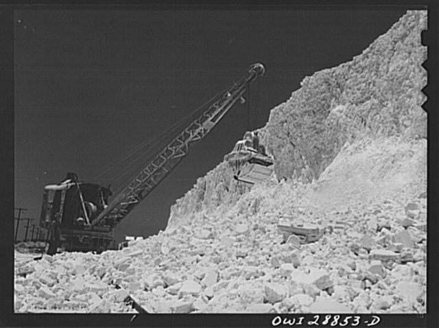 Freeport Sulphur Company, Hoskins Mound, Texas. Clearing sulphur off railroad tracks after blasting