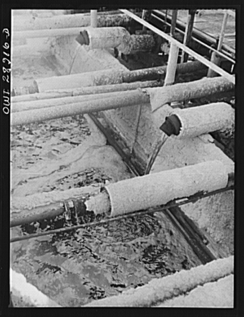Freeport Sulphur Company, Hoskins Mound, Texas. Molten sulphur pouring into a tank at relay station