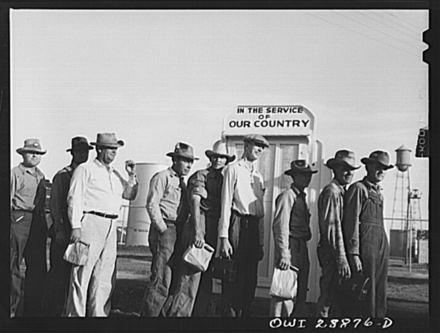 Freeport Sulphur Company, Hoskins Mound, Texas. Sulphur workers arriving at the plant