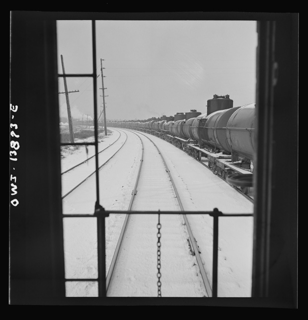 Freight operations on the Indiana Harbor Belt railroad between Chicago, Illinois and Hammond, Indiana. As the train goes through Argo, Illinois, it passes a long train of oil tank cars of the Baltimore and Ohio railroad
