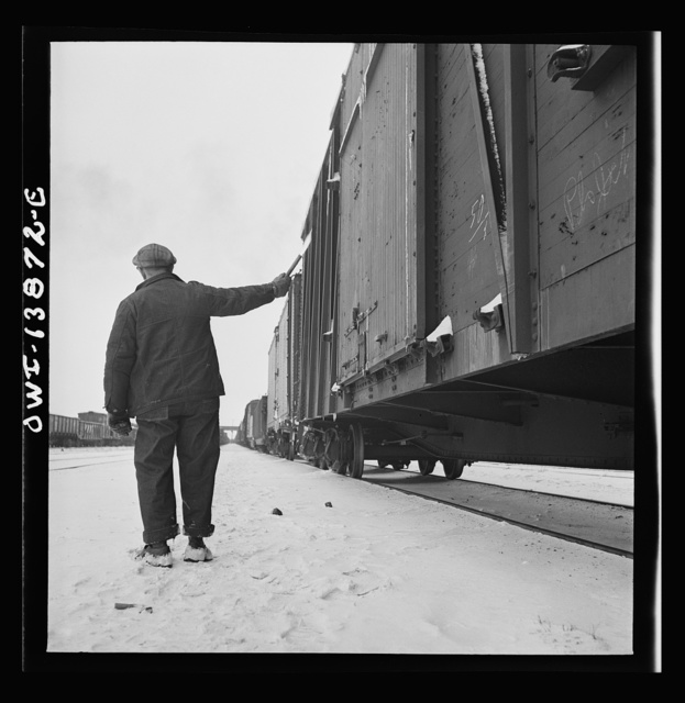 "Freight operations on the Indiana Harbor Belt railroad between Chicago, Illinois and Hammond, Indiana. Having inspected the train, the conductor signals the ok with a ""fusee"""