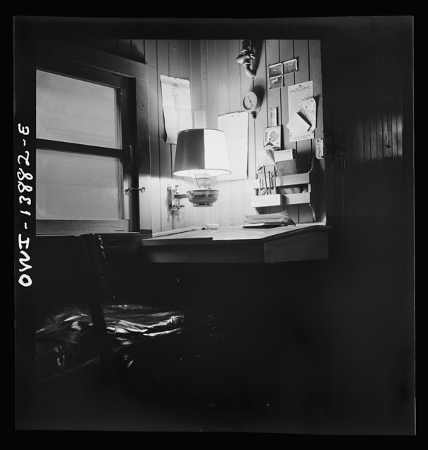 Freight operations on the Indiana Harbor Belt railroad between Chicago, Illinois and Hammond, Indiana. The conductor's work desk in the caboose. The dial on the wall is an air pressure gauge