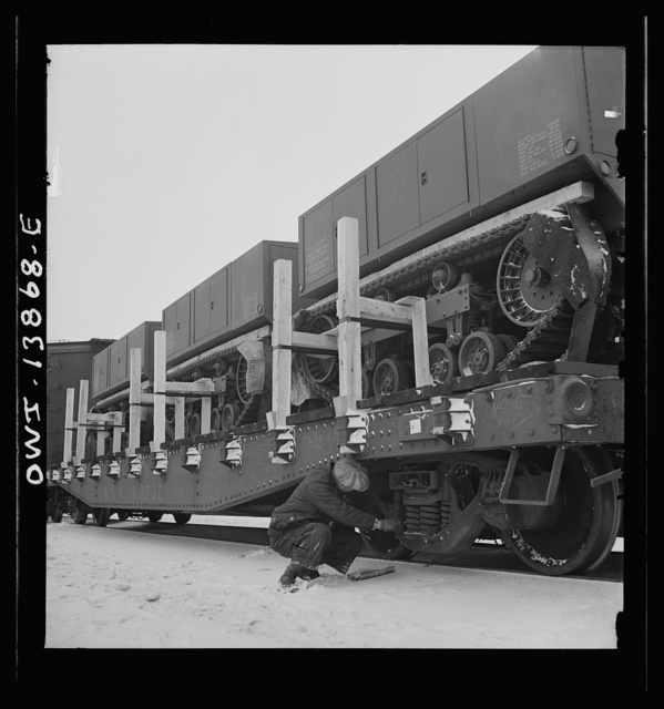 Freight operations on the Indiana Harbor Belt railroad between Chicago, Illinois and Hammond, Indiana. Conductor Cunningham makes an inspection of the train he is to deliver while on his way to the yard office