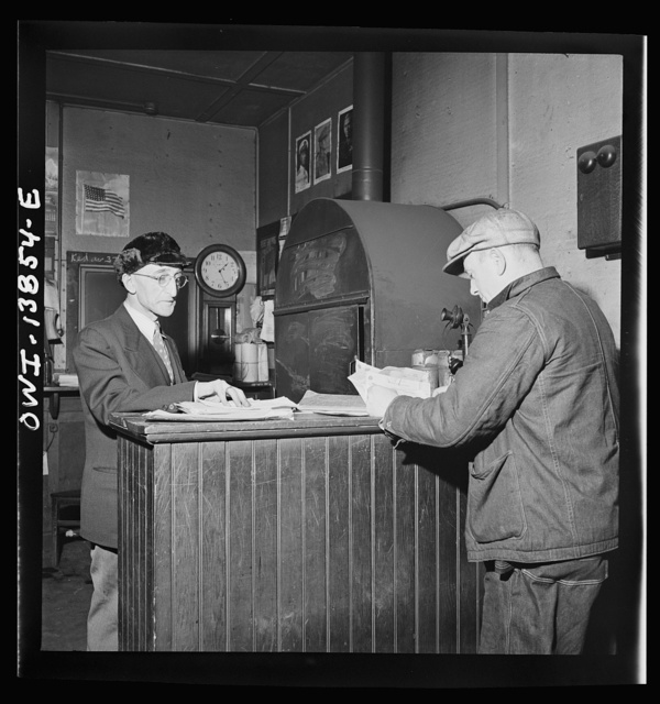 Freight operations on the Indiana Harbor Belt railroad between Chicago, Illinois and Hammond, Indiana. Conductor Cunningham reports at the yard office where the yard clerk gives him the waybills for the train and instructions to deliver it