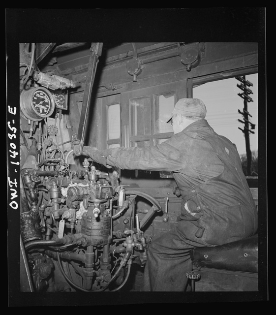 Freight train operations on the Chicago an Northwestern Railroad between Chicago and Clinton, Iowa. In the engineer's cab, after the train has arrived at Clinton and the engine is being taken over to the roundhouse. Note that the key has been put back into the automatic train control mechanism