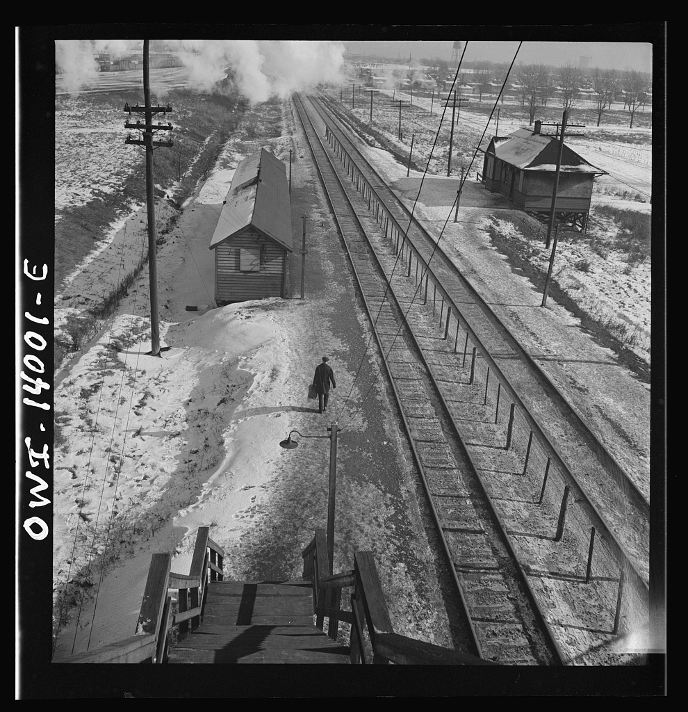 Freight train operations on the Chicago and Northwestern Railroad between Chicago and Clinton, Iowa. The journey ended, conductor Wolfsmith walks to the little passenger station to wait for a suburban train to take him home to Chicago