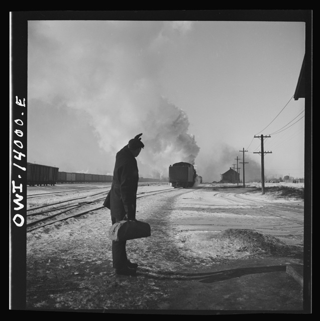 Freight train operations on the Chicago and Northwestern Railroad between Chicago and Clinton, Iowa. At the end of the trip, the engine goes off to the roundhouse as conductor Wolfsmith waves good-bye to the engine crew