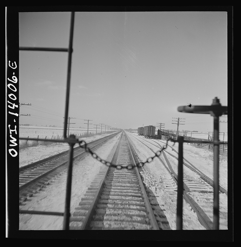 Freight train operations on the Chicago and Northwestern Railroad between Chicago and Clinton, Iowa. On its way back from Clinton, Iowa, the train passes many sidings where stock cars wait to be loaded with cattle