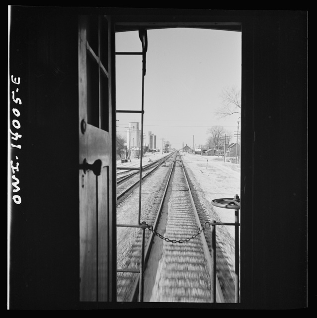 Freight train operations on the Chicago and Northwestern Railroad between Chicago and Clinton, Iowa. The train rushing through the town of Malta, Illinois on its way to Clinton