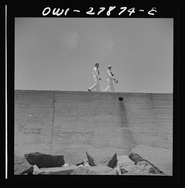 Galveston, Texas. Two sailors walking along the seawall