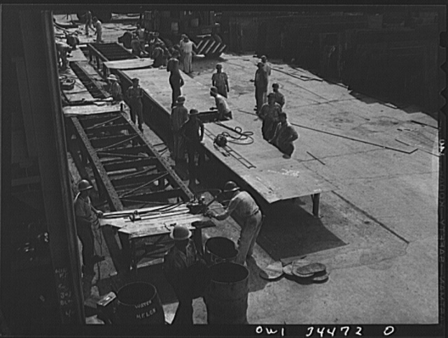 Getting steel plates ready for installation. Higgins shipyards, New Orleans, Louisiana