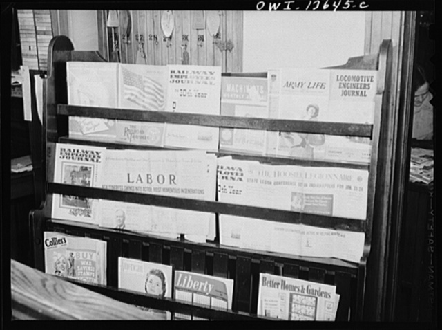 Gibson, Indiana. Newspaper and magazine rack at the railroad YMCA (Young Men's Christian Association)