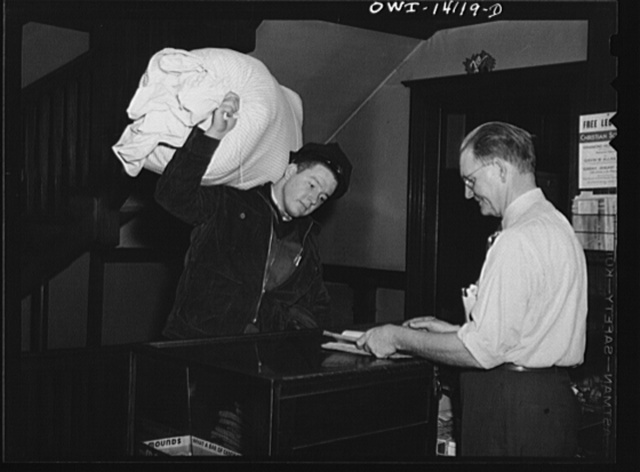 Gibson, Indiana. Several sacks of work clothes go to the laundry from the railroad YMCA (Young Men's Christian Association) every day