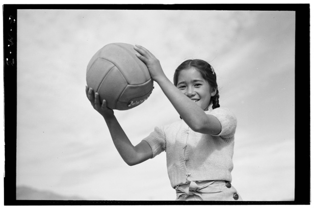 Girl and volley ball / photograph by Ansel Adams.