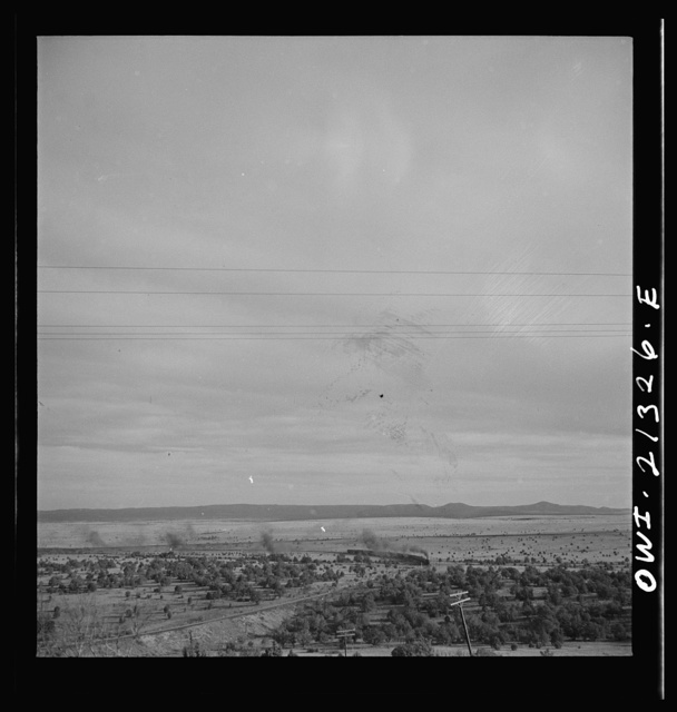 Gleed, Arizona. A westbound passenger train going around a curve on the Atchison, Topeka and Santa Fe Railroad between Winslow and Seligman, Arizona