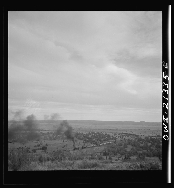 Gleed (vicinity), Arizona. A westbound double-header freight train going around a curve on the Atchison, Topeka, and Santa Fe Railroad between Winslow and Seligman, Arizona