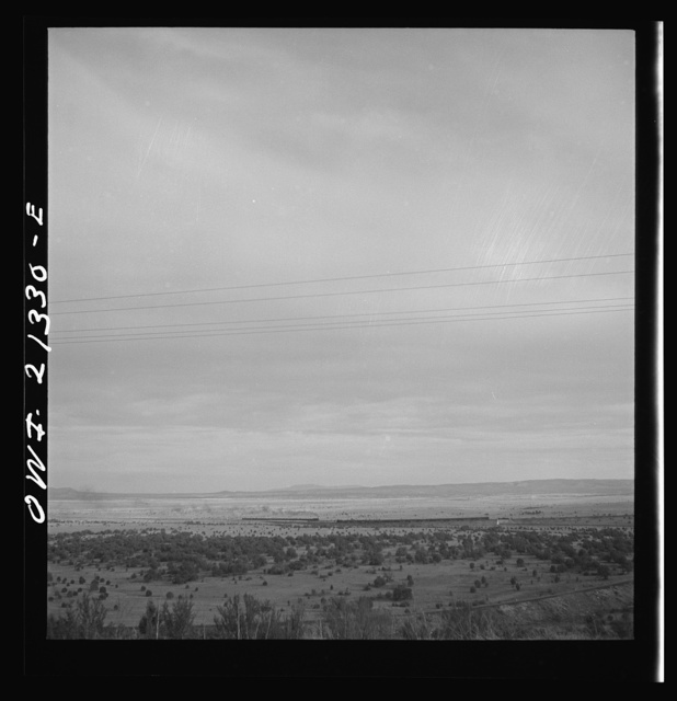 Gleed (vicinity), Arizona. East and westbound trains passing on the Atchison, Topeka and Santa Fe Railroad between Winslow and Seligman, Arizona
