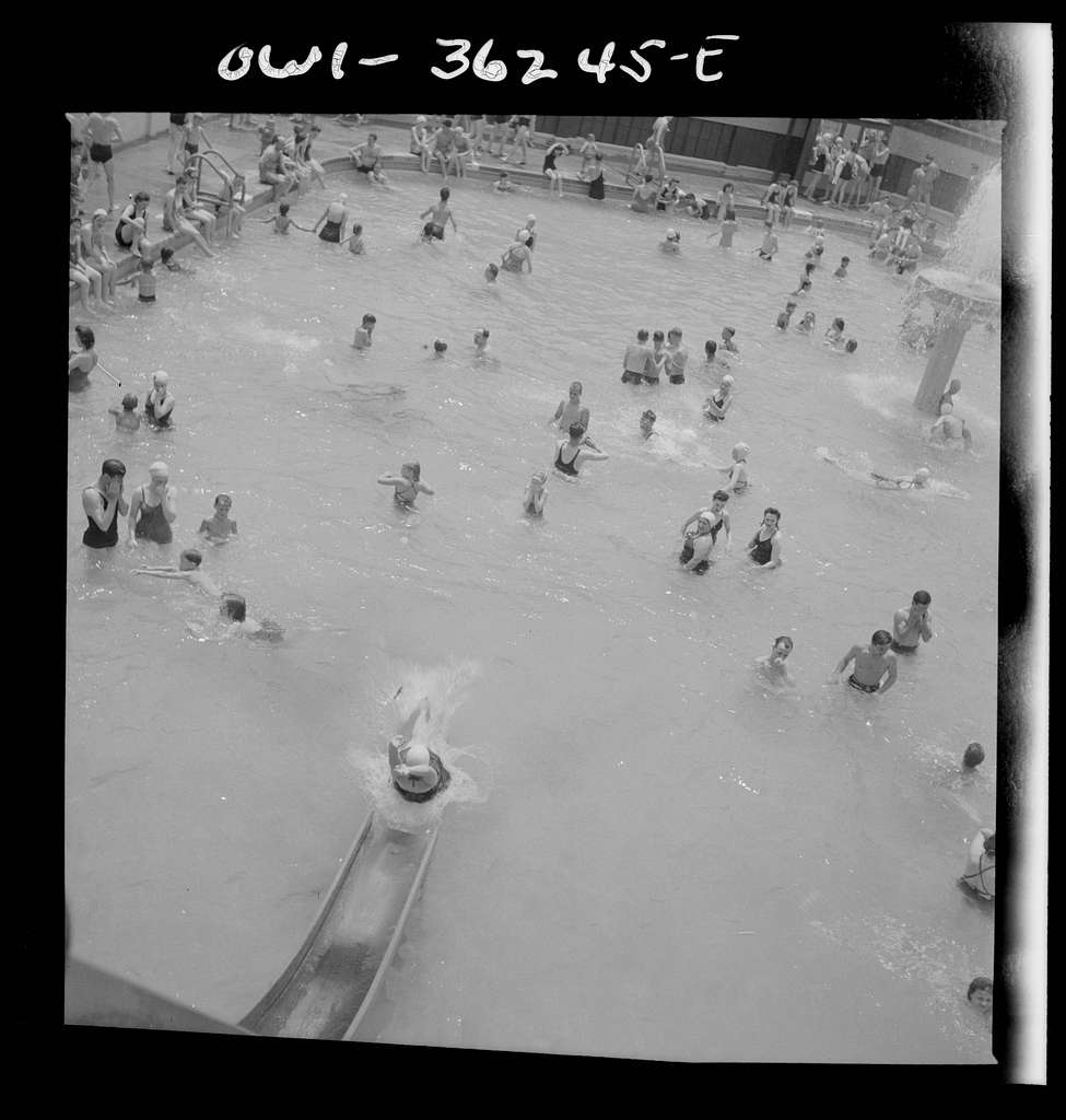 Glen Echo, Maryland. A bather sliding down the waterslide at the Glen Echo swimming pool