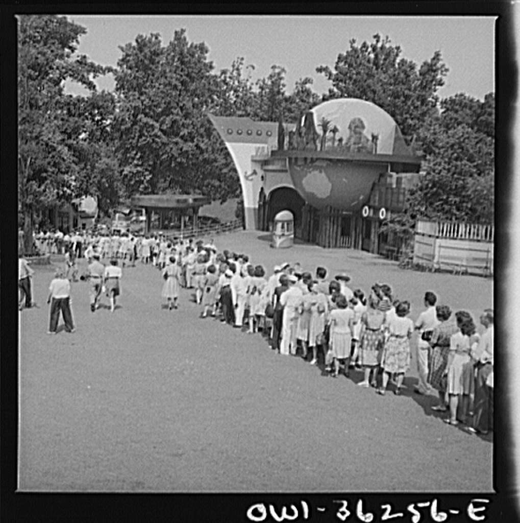 Glen Echo, Maryland. A line of people waiting to get into the swimming pool at the Glen Echo amusement park on a hot day