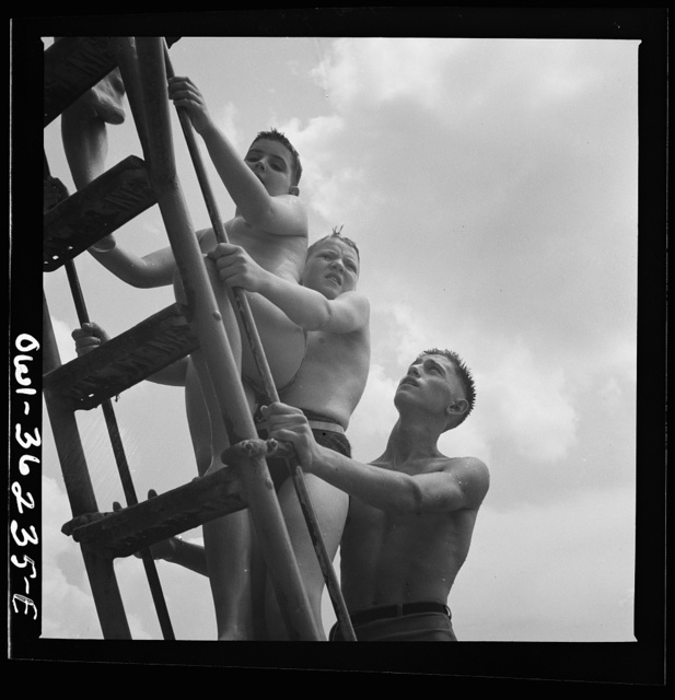 Glen Echo, Maryland. Climbing the ladder to the sliding board at the swimming pool