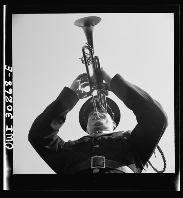 Gloucester, Massachusetts. Memorial Day, 1943. A Legionaire sounding taps for the War dead during services