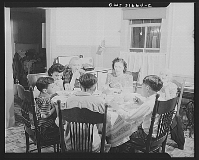 Gloucester, Massachusetts. Mrs. Isabell Lopez, her mother, children and grandchildren having dinner. Mr. Lopez, is a fish skinner at Gorton-Pew Fisheries. With the exception of one day a week, he is working at dinner time