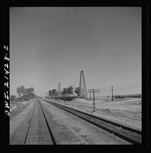 Goffs, California. Military tanks from a nearby army camp, loaded on flat cars along the Atchison, Topeka, and Santa Fe Railroad between Needles and Barstow, California