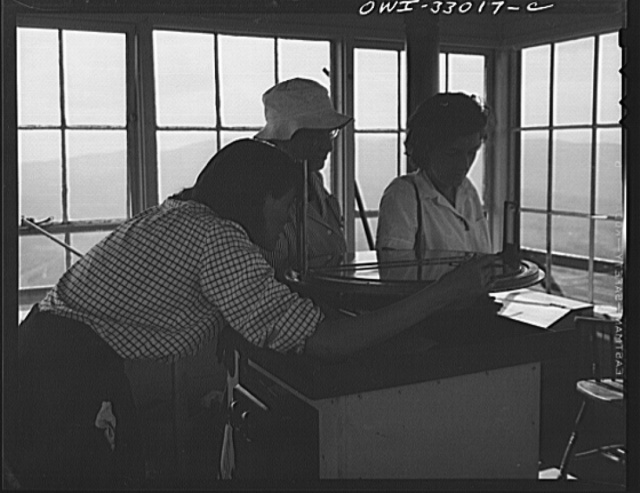 Gorham (vicinity), New Hampshire. Many visitors climb up from Gorham to visit the fire lookout tower on Pine Mountain. Barbara Mortensen, as fire guard for the national forests, uses these occasions to educate the public in fire prevention and conservation