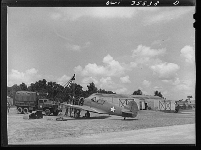 Greenville, South Carolina. Air Service Command. At the 25th service squadron engineering line. In the background are the shops camouflaged to look like farm buildings