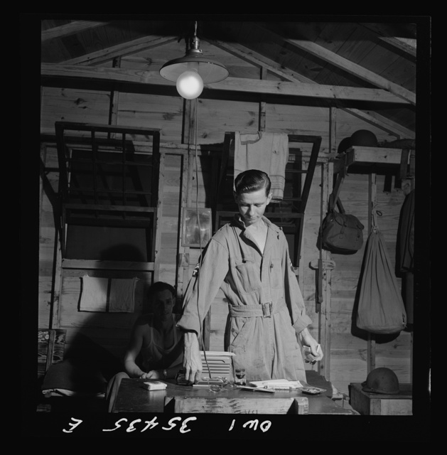 Greenville, South Carolina. Air Service Command. Enlisted man of the 25th service group relaxing in his hutment