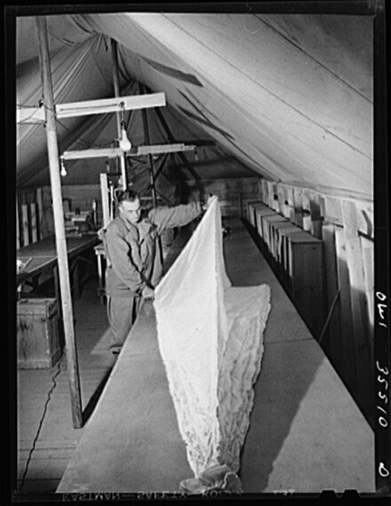 Greenville, South Carolina. Air Service Command. Inspecting parachutes at the 35th service squadron of the 25th service group