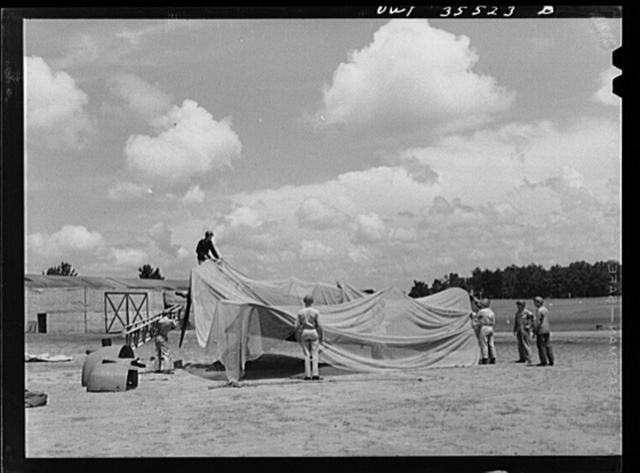 Greenville, South Carolina. Air Service Command. Men of the 35th service squadron of the 25th service group, spreading camouflage netting over a plane