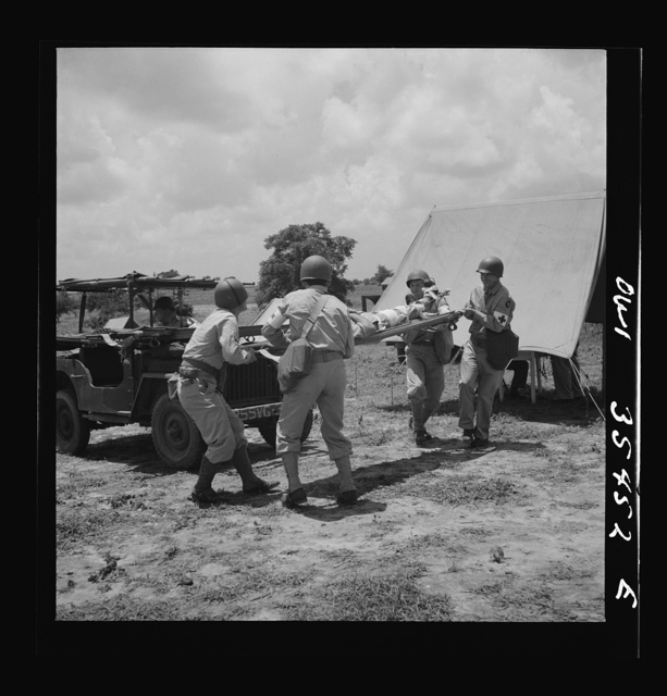 Greenville, South Carolina. Air Service Command. Men of the medical unit of the 25th service group demonstrating the carrying of wounded men by means of stretchers on jeeps