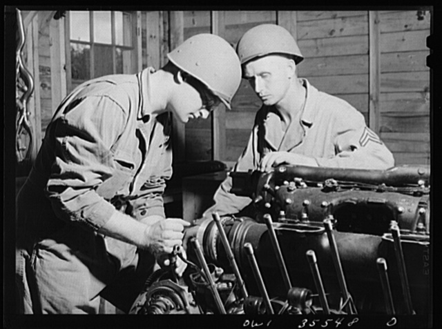 Greenville, South Carolina. Air Service Command. Sergeant John Riley of the 25th service group getting instruction on the Rolls Royce aircraft motor