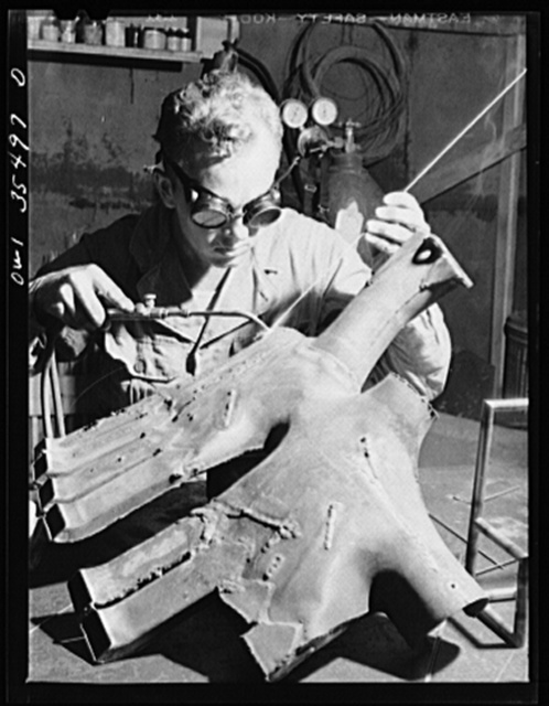 Greenville, South Carolina. Air Service Command. Welder of the 35th service squadron of the 25th service group practicing welding on an old engine exhaust