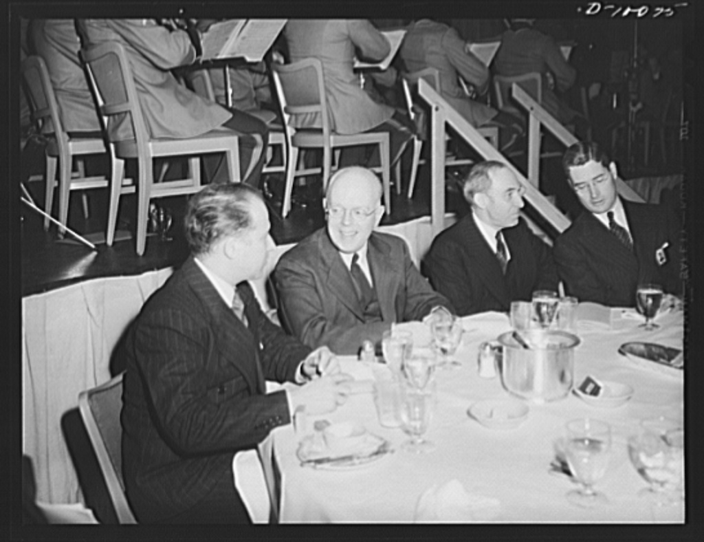 Guests at luncheon of dehydrated food held at the Hotel Statler, Washington, D.C., on second anniversary of lend-lease: Leslie Wheeler, Department of Agriculture; John D. East, Lend-lease Administration; Boaz Long, United States ambassador to Ecuador; Blackwell Smith, War Production Board (WPB)