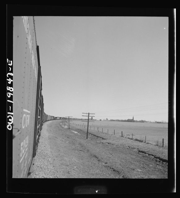 Harper, Kansas. Atchison, Topeka and Santa Fe Railroad train between Wellington, Kansas and Waynoka, Oklahoma approaching the town