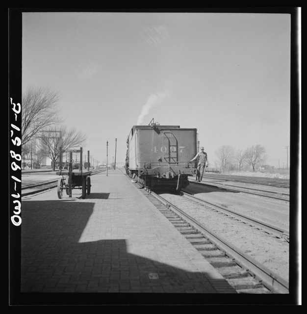 Harper, Kansas. Engine going off to get water at opposite end of the platform on the Atchison, Topeka and Santa Fe Railroad between Wellington, Kansas and Waynoka, Oklahoma