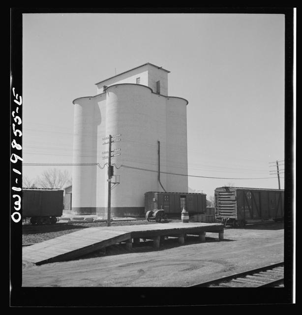 Harper, Kansas. Grain elevator along the Atchison, Topeka and Santa Fe Railroad between Wellington, Kansas and Waynoka, Oklahoma
