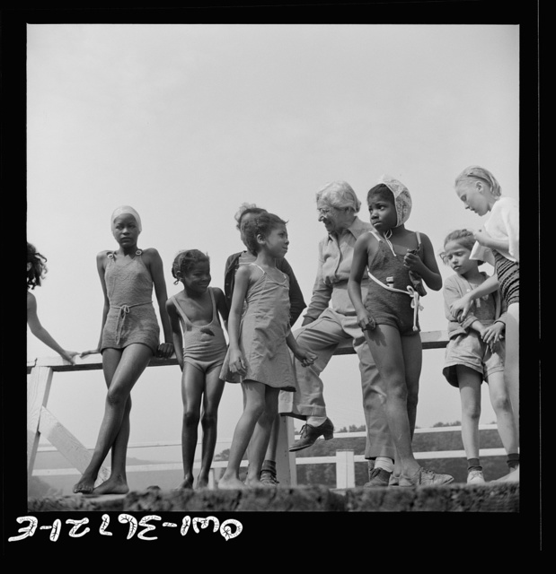 Haverstraw, New York. Interracial activities at Camp Christmas Seals, where children are aided by the Methodist Camp Service. Mrs. Addie C. Cox, director, giving instruction to the campers before the swim