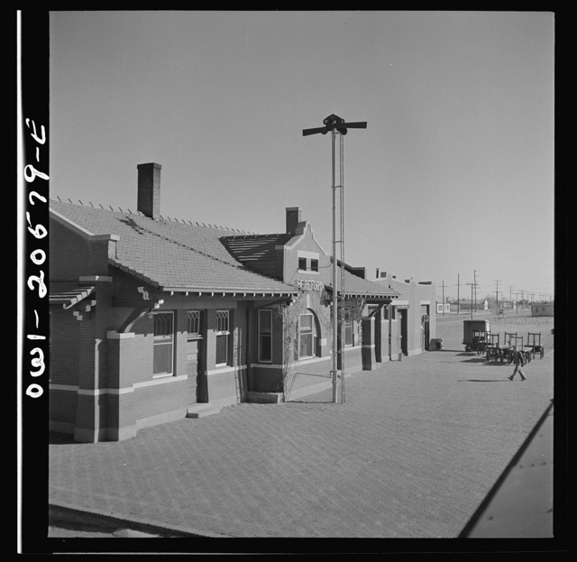 Hereford, Texas. Passing the depot on the Atchison, Topeka, and Santa Fe Railroad between Amarillo, Texas and Clovis, New Mexico