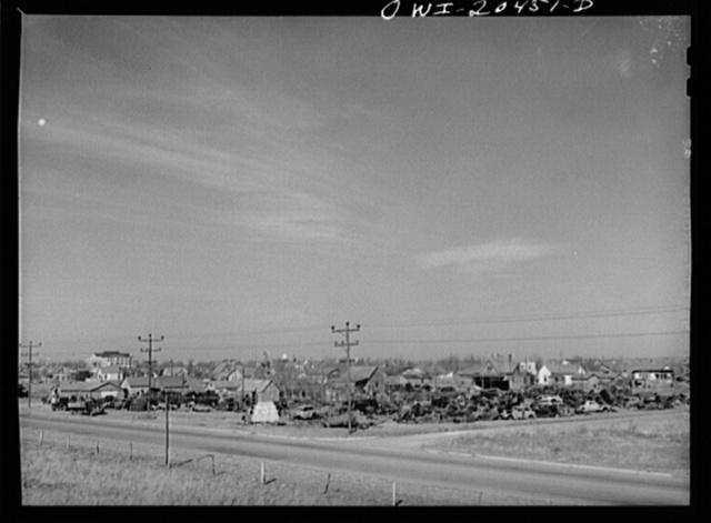 Hereford (vicinity), Texas. Auto junkyard along the Atchison, Topeka and Santa Fe Railroad