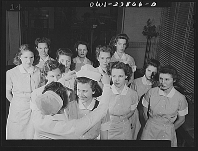 """High point in the student nurse's career is the meaningful """"capping"""" ceremony which takes place after students have completed the preliminary portion of their training. Here, Frances Bullock, nineteen-year-old student nurse, receives her cap"""