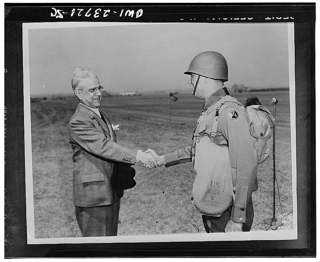 His Excellency Cimon P. Diamattoupoulos congratulates Brigadier General Louis J. Portier (Division Artillery Commander, 94th Infantry division) after presenting the Order of George I to him