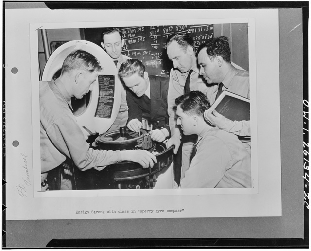 "Hoffman Island, New York.  Ensign Strong instructing class on the ""sperry"" gyro compass at the United States Maritime Service training school"
