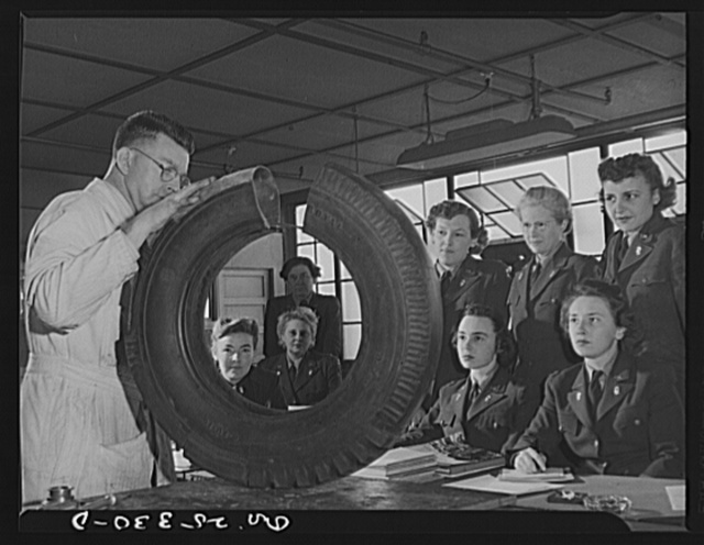 Holabird ordnance depot, Baltimore, Maryland. A group of WAACS (Women's Auxiliary Army Coprs) receive instruction in tire structure and care as part of the automotive preventive maintenance course which all Army men and women at Holabird must take. Instructor is H.T. McKinley of Baltimore, Maryland. WAACS are, left to right: (seated) Mary Triplett, 2nd officer, Denver; Eva V. Alexander, 3rd officer, Los Angeles, California; Ruth M. Anderson, 3rd officer, Saint Paul, Minnesota; Betty Brewer, 3rd officer, Atlanta, Georgia. Standing: Rachel Barnett, 3rd officer, Fort Wayne, Texas. Mildred Cribby, 3rd officer, Saint Petersburg, Florida; Ura M. Ankrom, 3rd officer, Cleveland, Ohio and Dorothy Irwin, 3rd officer, Chicago, Illinois
